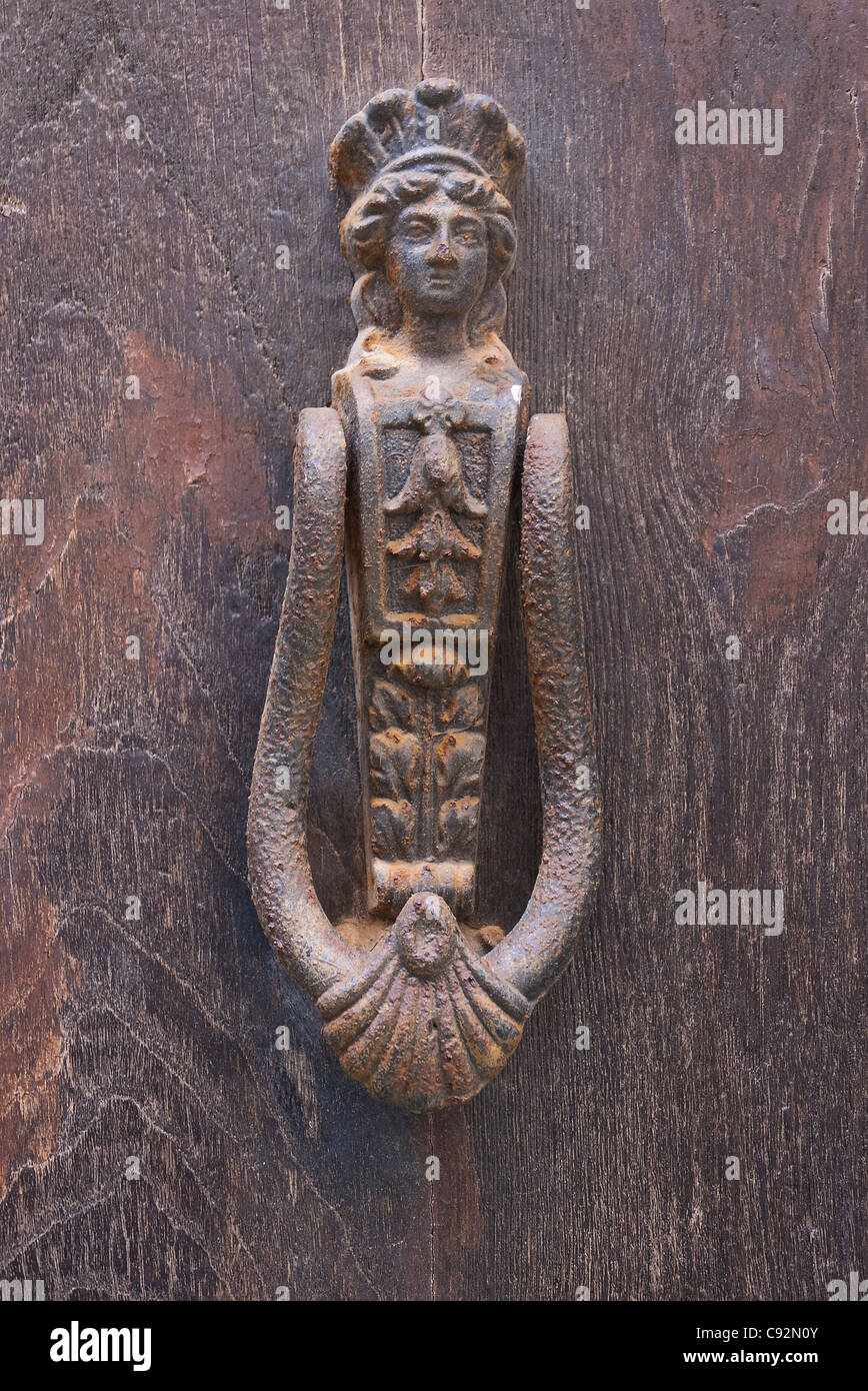 A Classic Door Knocker In A Womanu0027s Form, Rusted And Weathered On A Door In