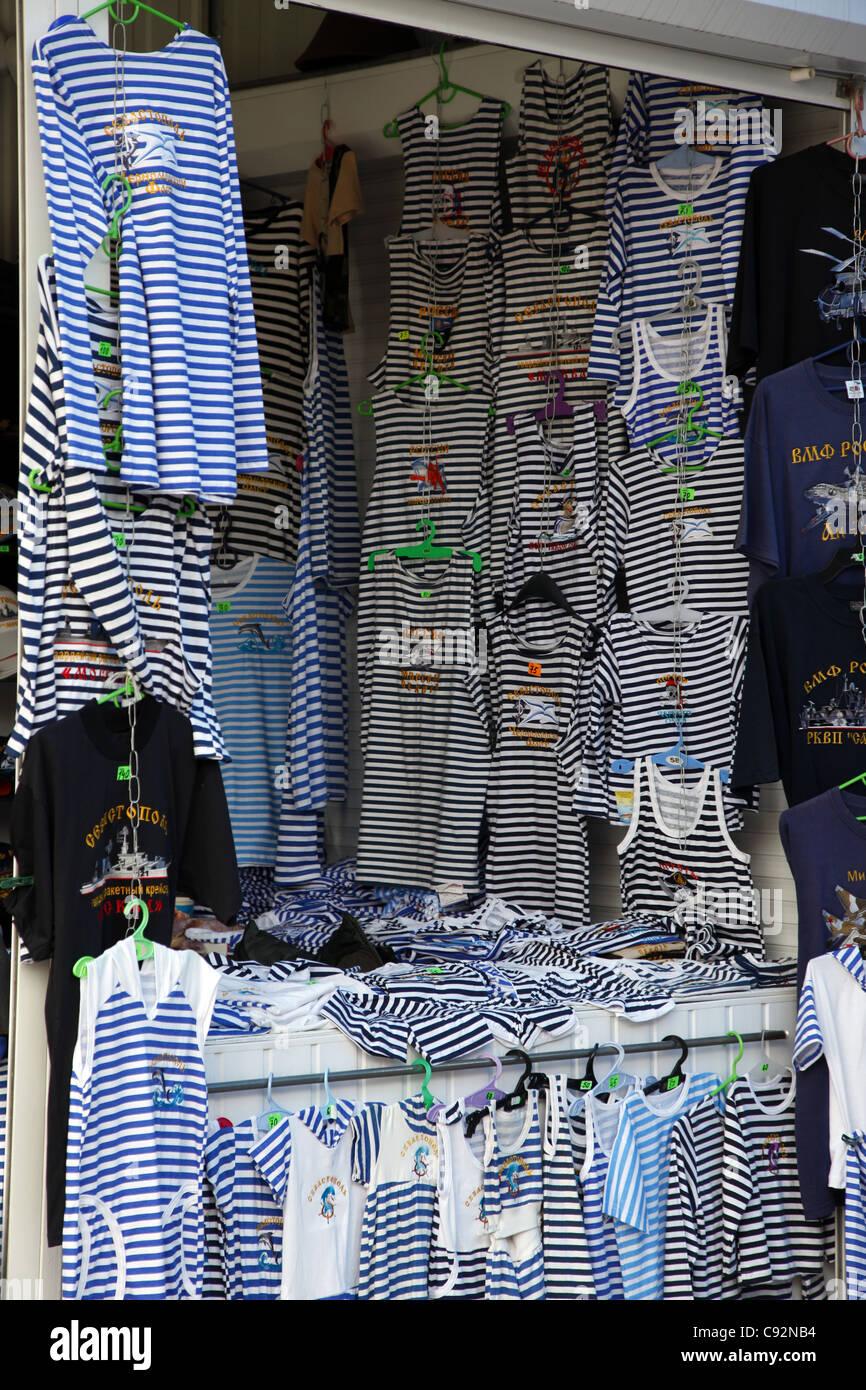 BLUE BLACK & WHITE HOOPED TEE SHIRTS SEVASTOPOL CRIMEA UKRAINE 29 September 2011 - Stock Image