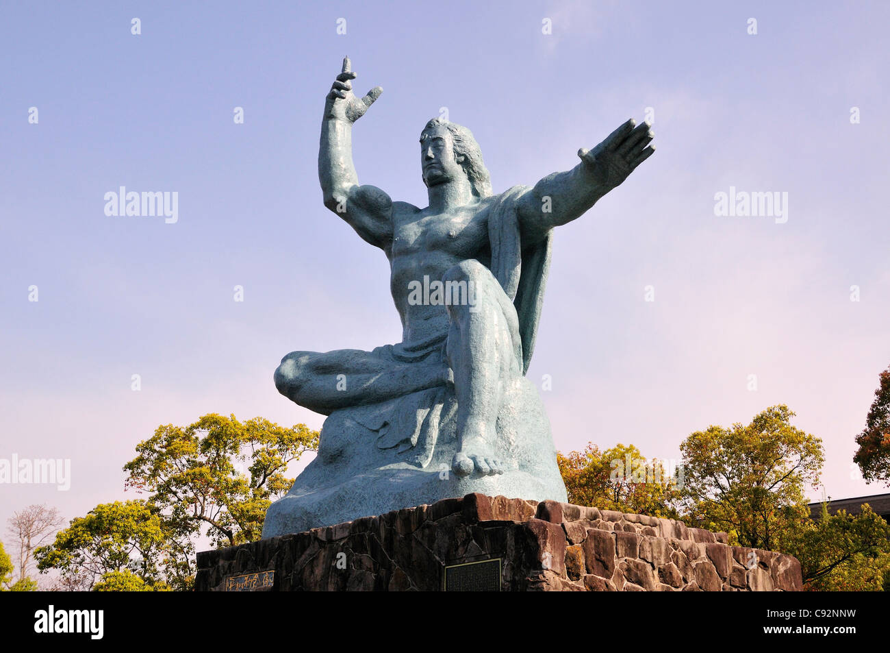 Nagasaki Peace Park commemorates the atomic bombing of the city during World War II. The 10 metre tall Peace Statue - Stock Image