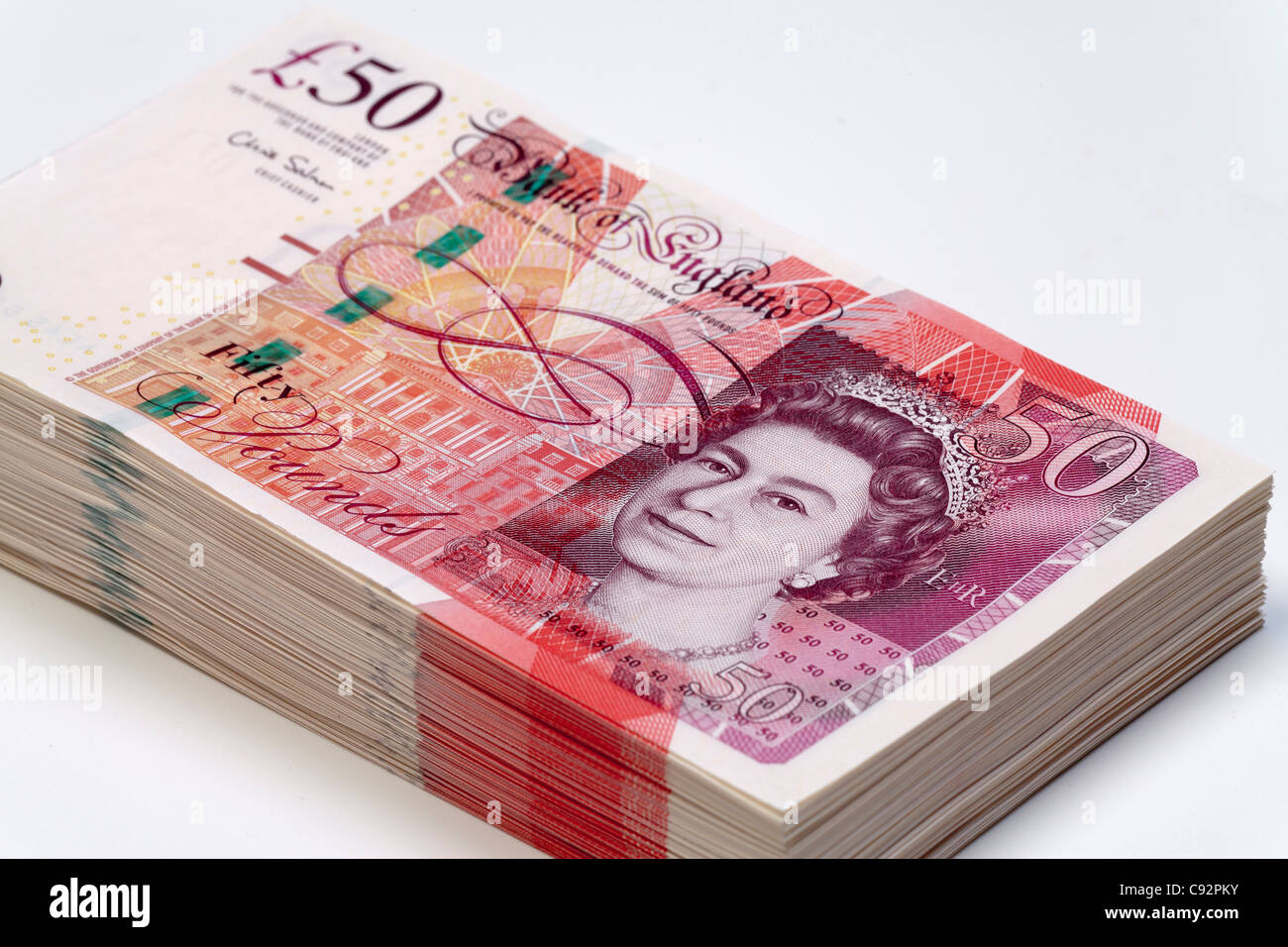 50 pound British currency bank notes £50 cash wealthy rich cash pile - Stock Image