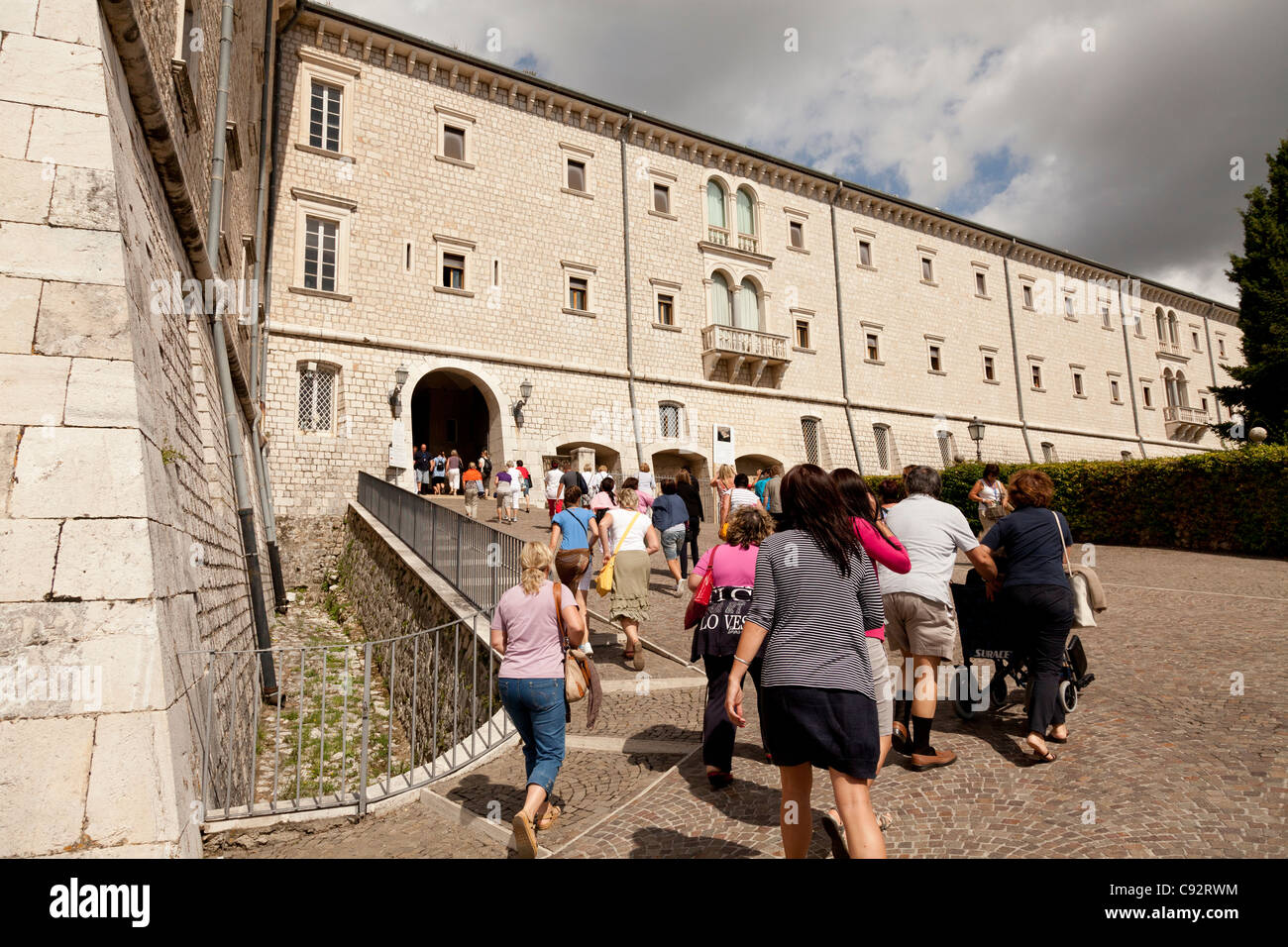 tourists entering monte cassino abbey - Stock Image