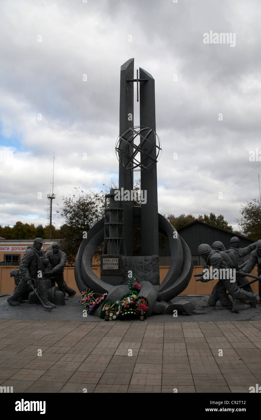 Monument to the firemen who died after trying to control the fire after the initial explosion at the Chernobyl nuclear - Stock Image