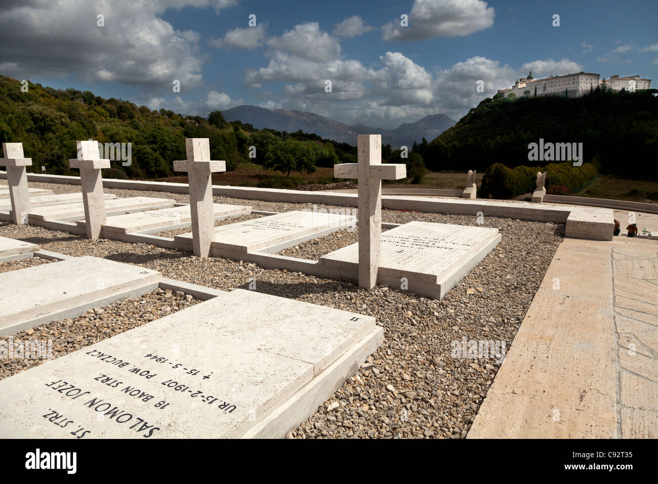 Gravestones in the Polish Cemetery standing proud towards the Abbey at Monte Cassino - Stock Image