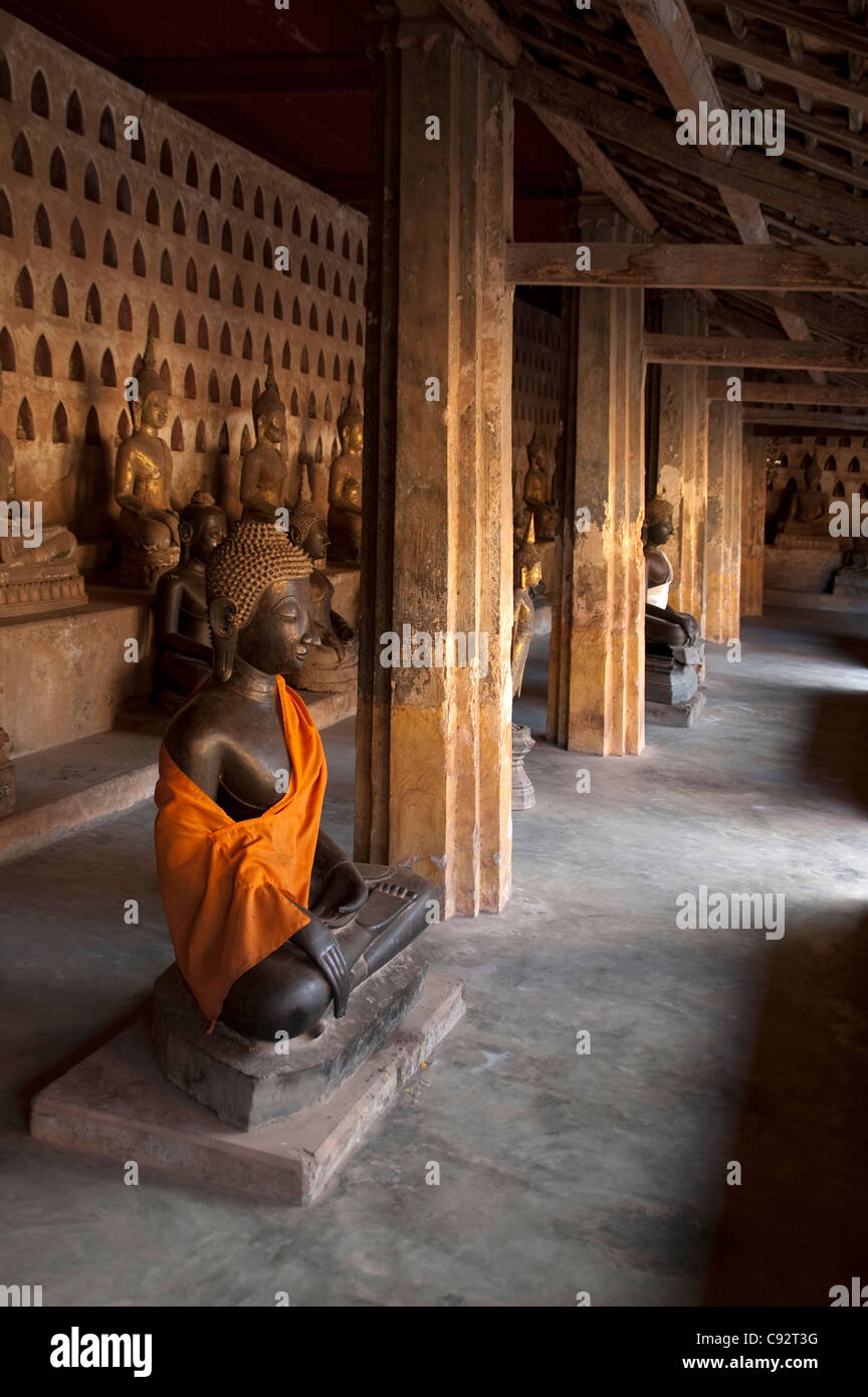 Buddhism is widespread in Laos with many temples containing highly revered Buddha images and sculpture. - Stock Image