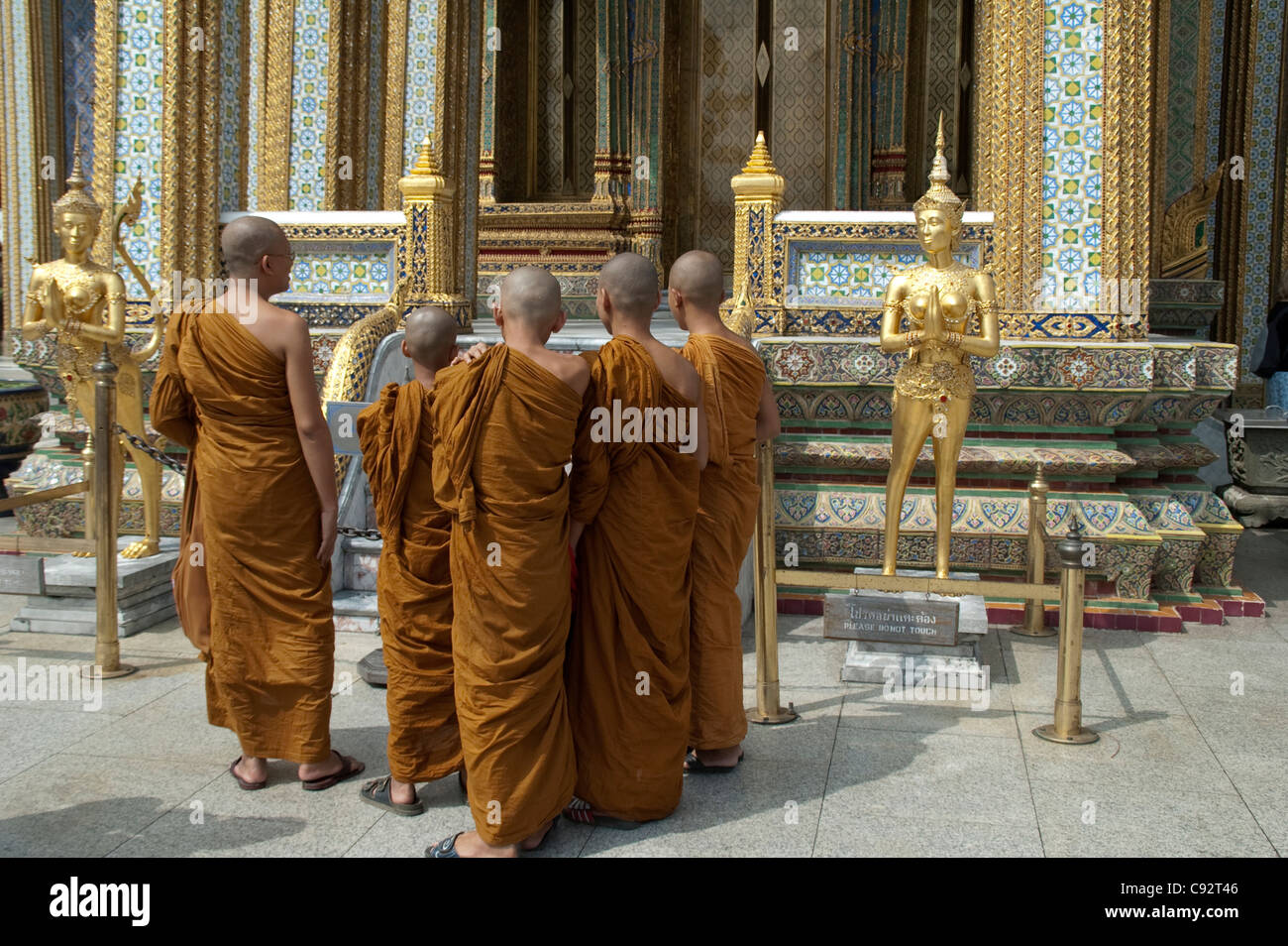 Wat Phra Kaew in the confines of the Grand Palace of Bangkok is the home of the highly revered Temple of the Emerald - Stock Image