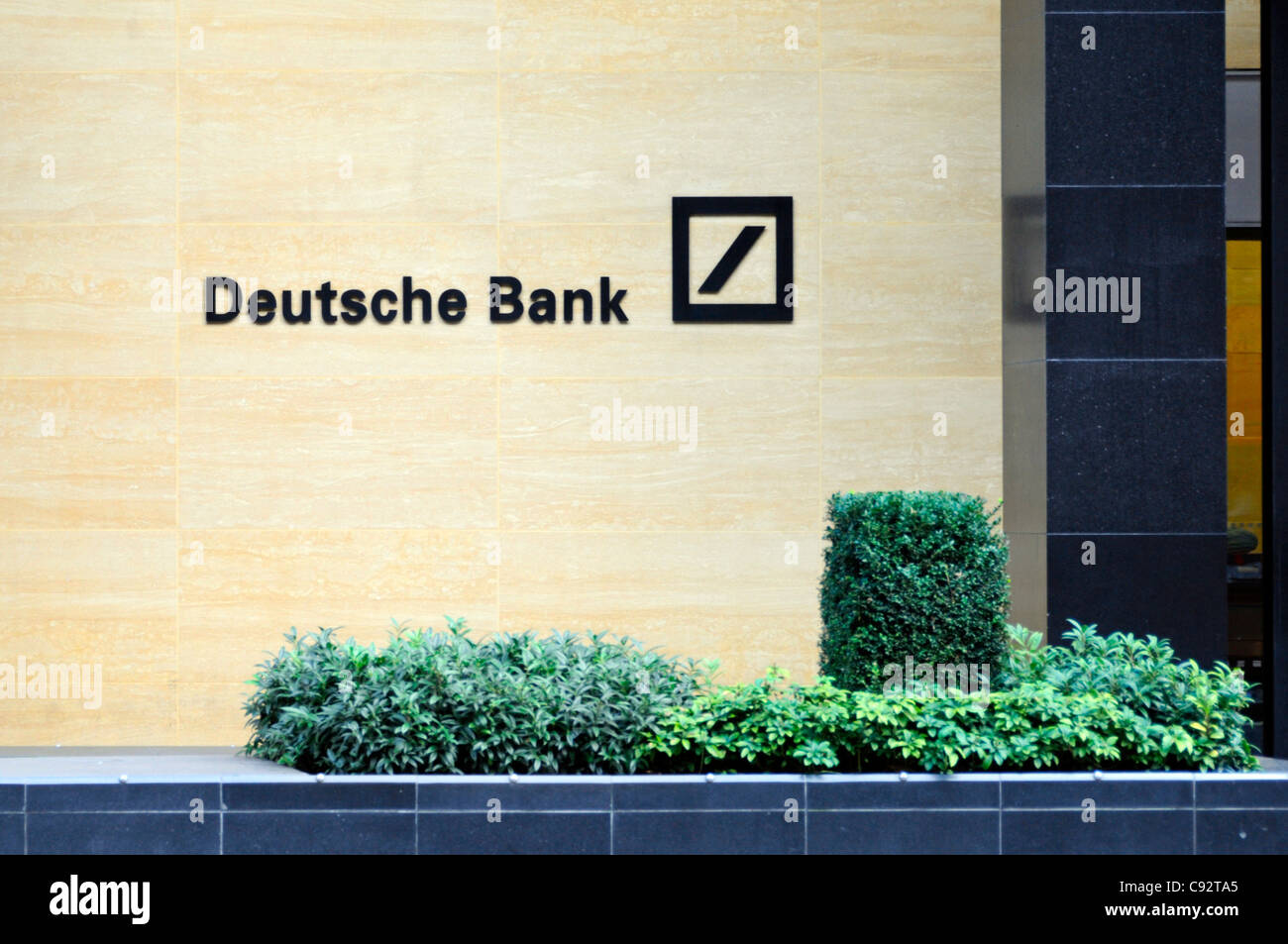 Deutsche Bank sign & logo on office building wall in the financial district square mile of the City of London - Stock Image