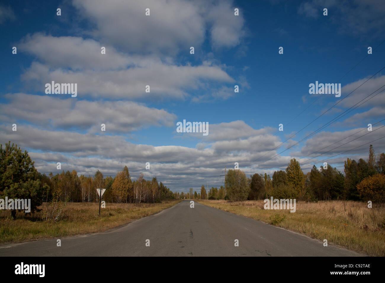 Empty road through the 10 km exclusion zone Chernobyl Ukraine Stock Photo