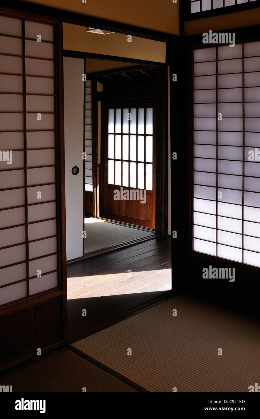 The interior of a traditional Japanese house with screen doors and wooden floors. - Stock Image