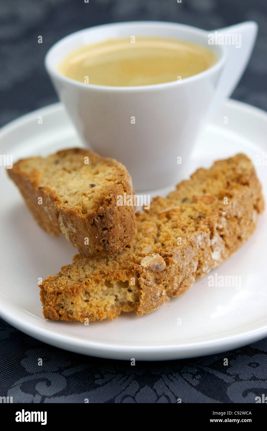 Home made vegan almond biscotti with a cup of coffee. Biscotti is a a twice-baked cake originating in the Italian Stock Photo