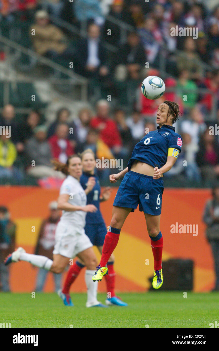 France team captain Sandrine Soubeyrand heads the ball during a 2011 FIFA Women's World Cup semifinal match - Stock Image