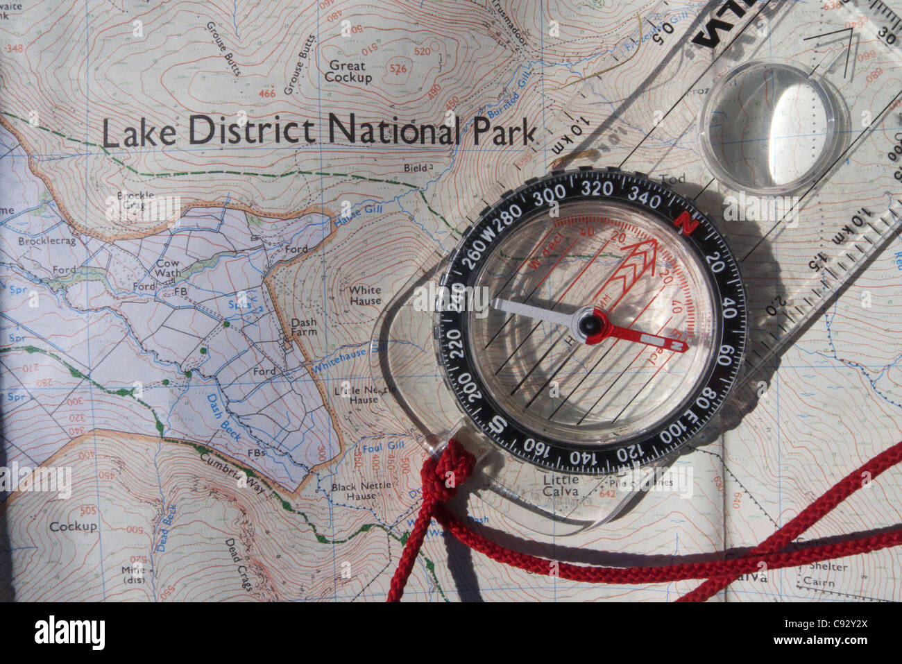 A map of the Lake District and a compass - Stock Image