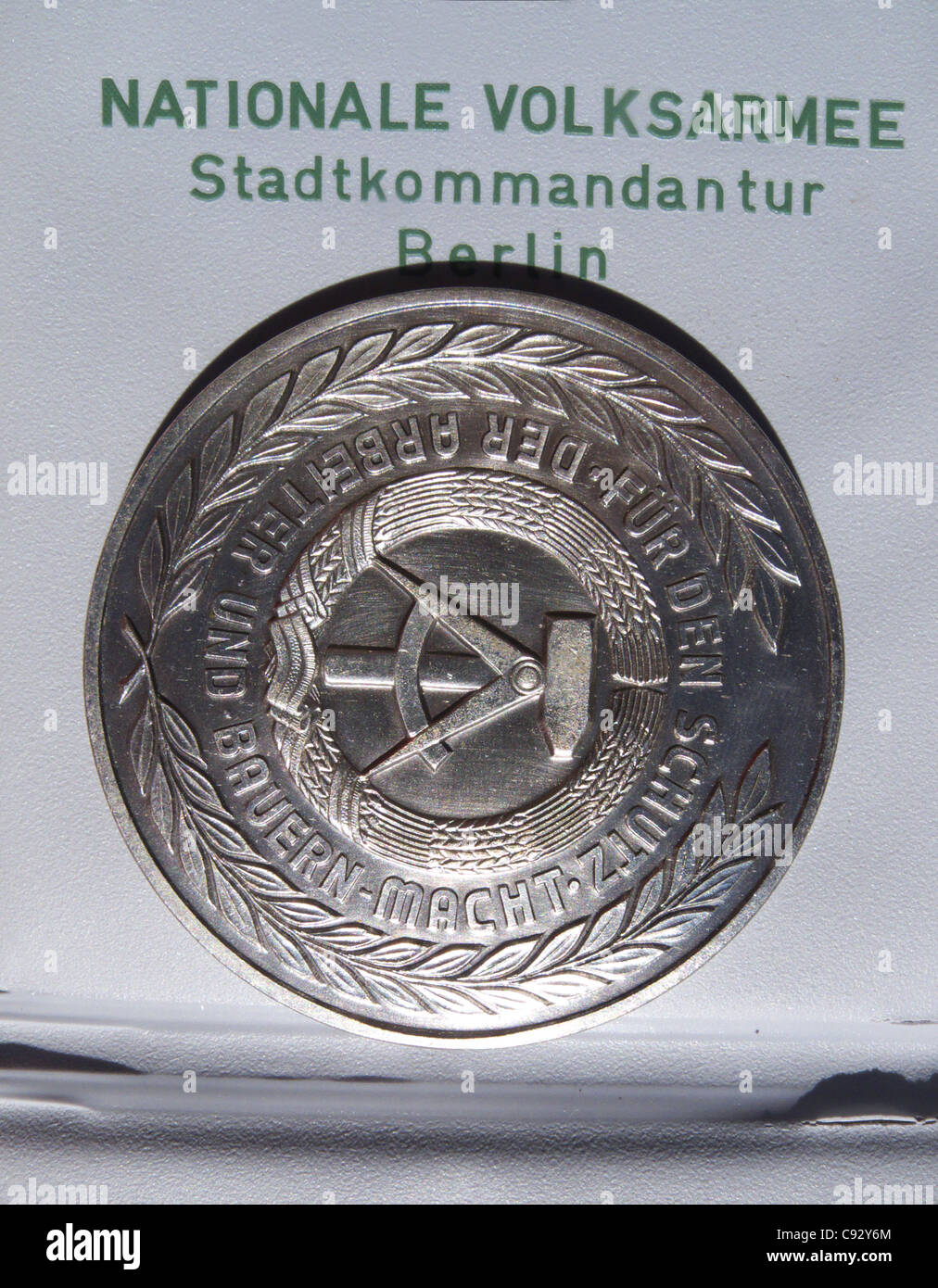 An East German medallion given to construction workers who helped put up the Berlin Wall overnight on the 13th august - Stock Image