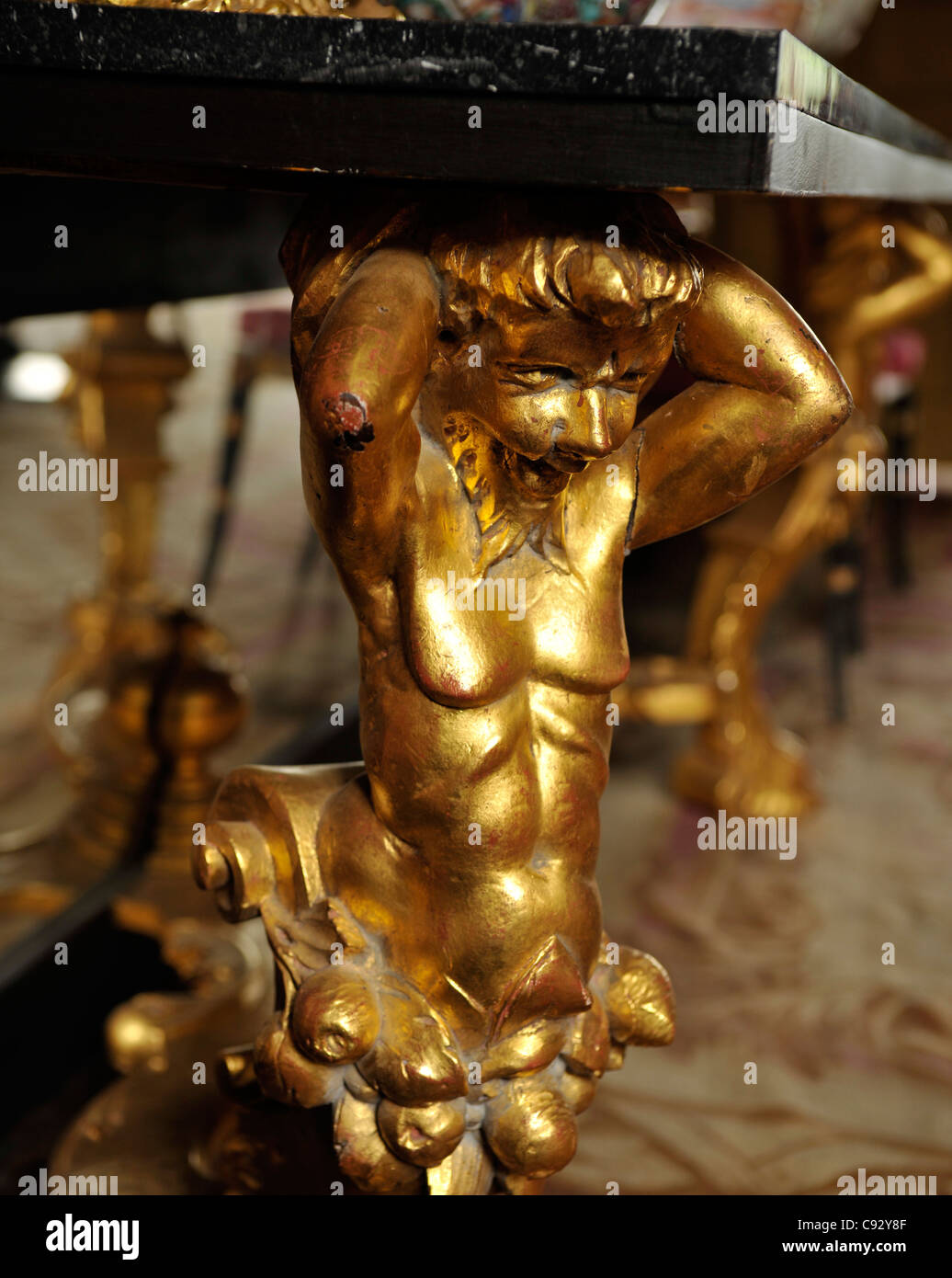 Ornate carved furniture depicting mythical creatures and gods were a popular way of denoting wealth and status in - Stock Image