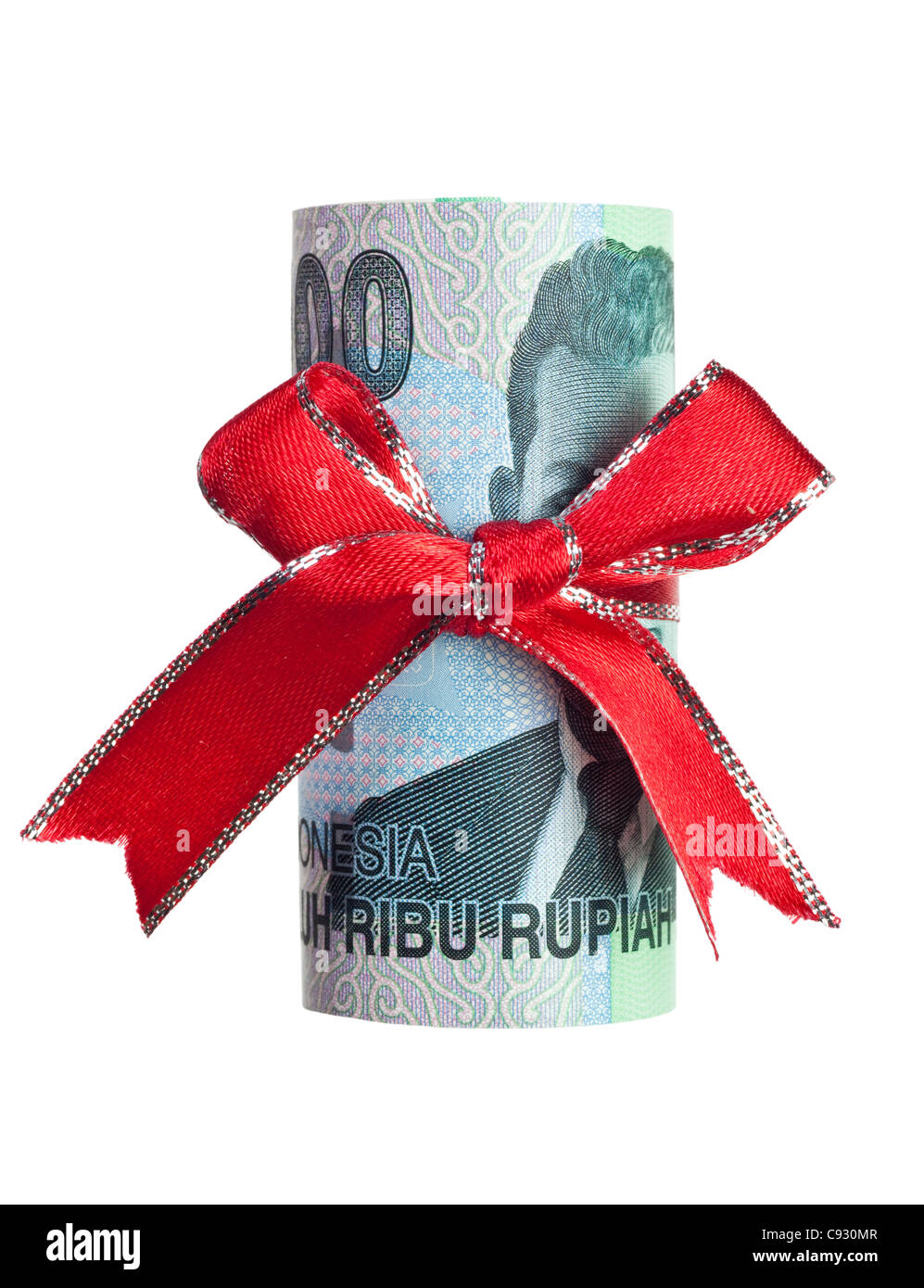 Indonesian Rupiah wrapped by ribbon isolated on white background - Stock Image