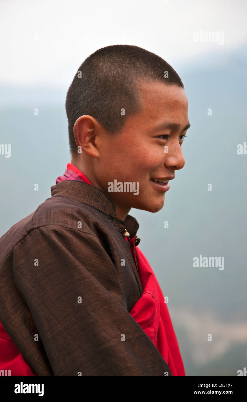 A young red-robed monk near Mongar. - Stock Image