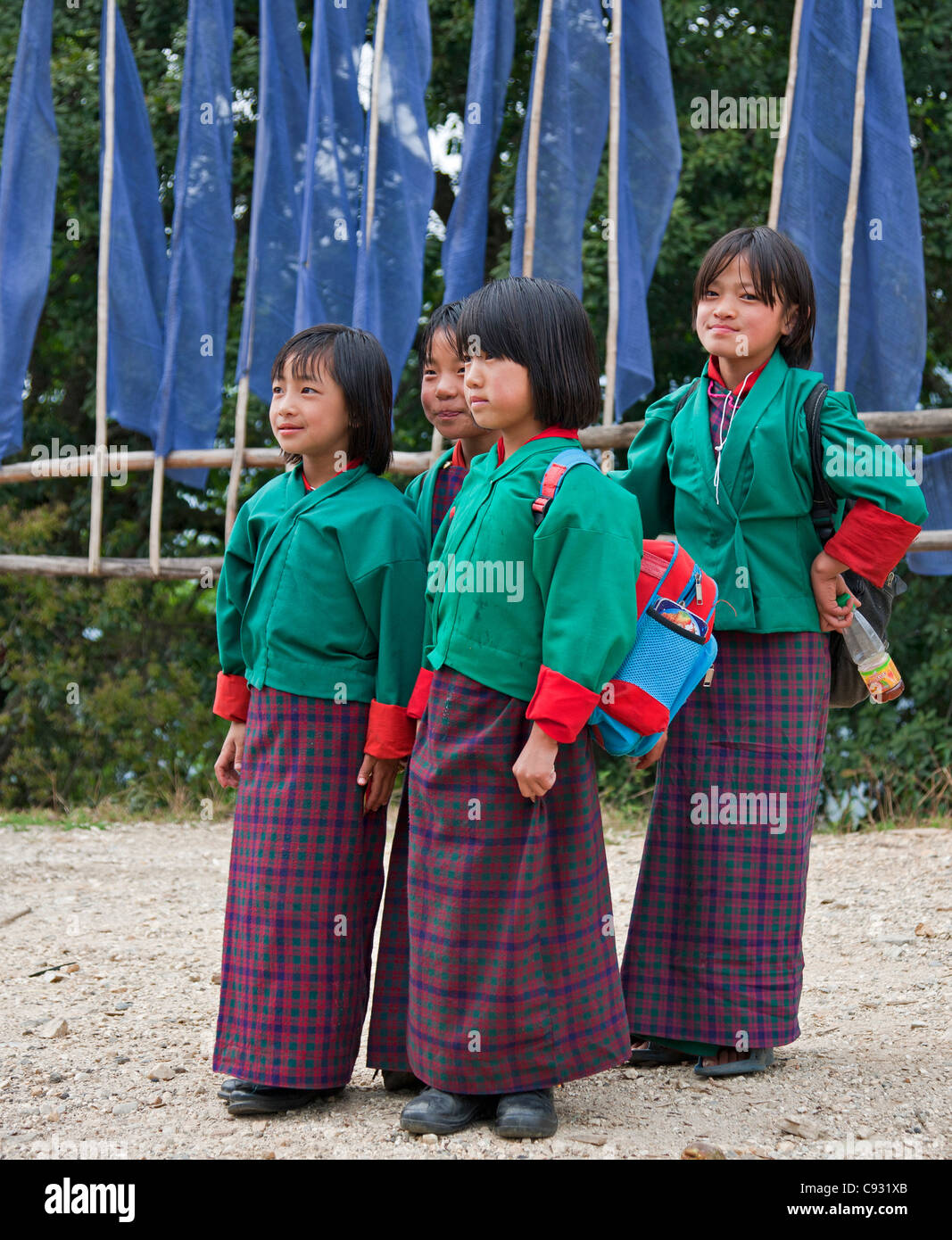 Schoolgirls on their way back from school near Mongar, a small hilltop town in East Bhutan. - Stock Image
