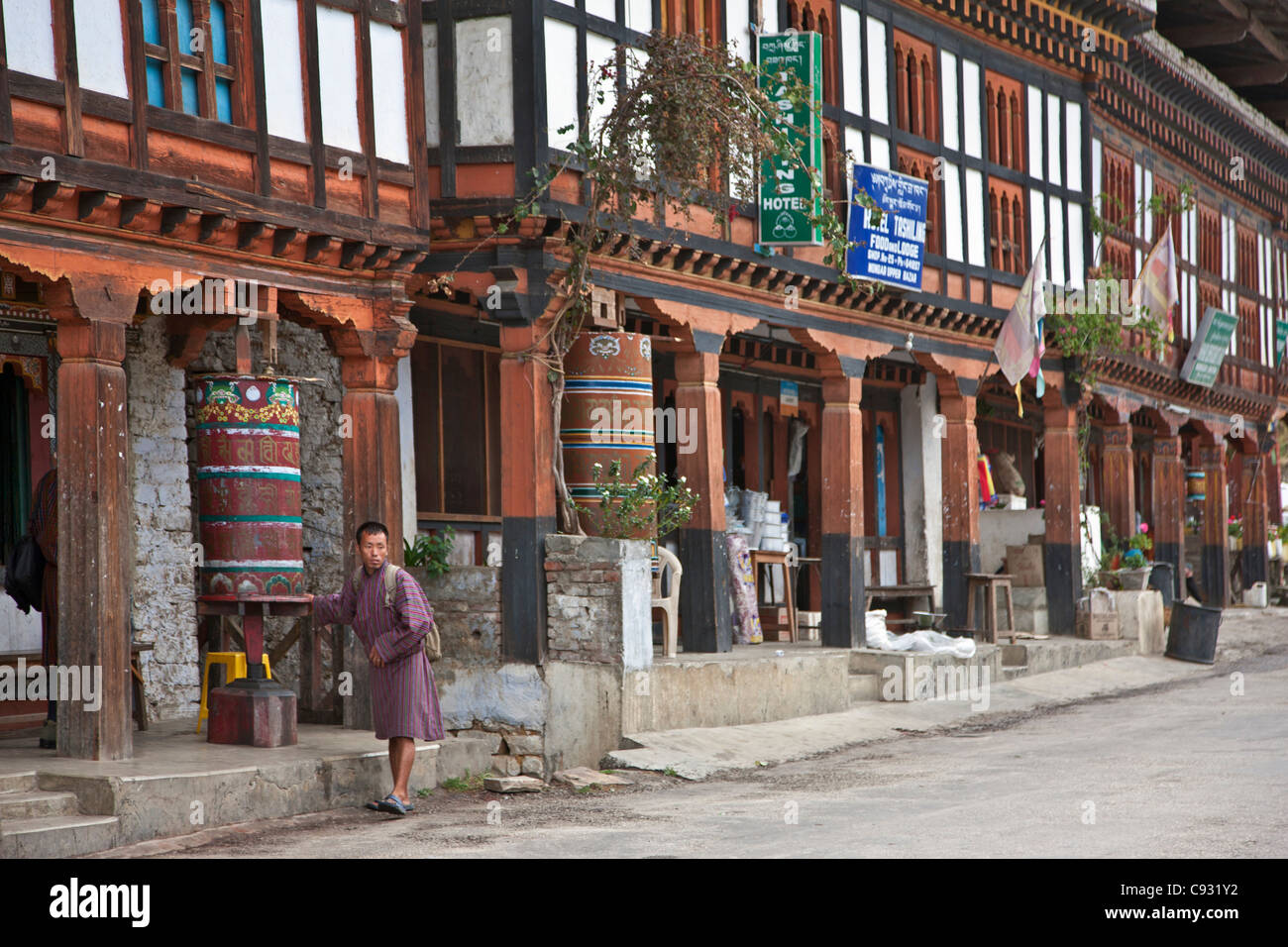 The main street in Mongar reflecting shops and local hotels built in the traditional Bhutanese architectural style. - Stock Image