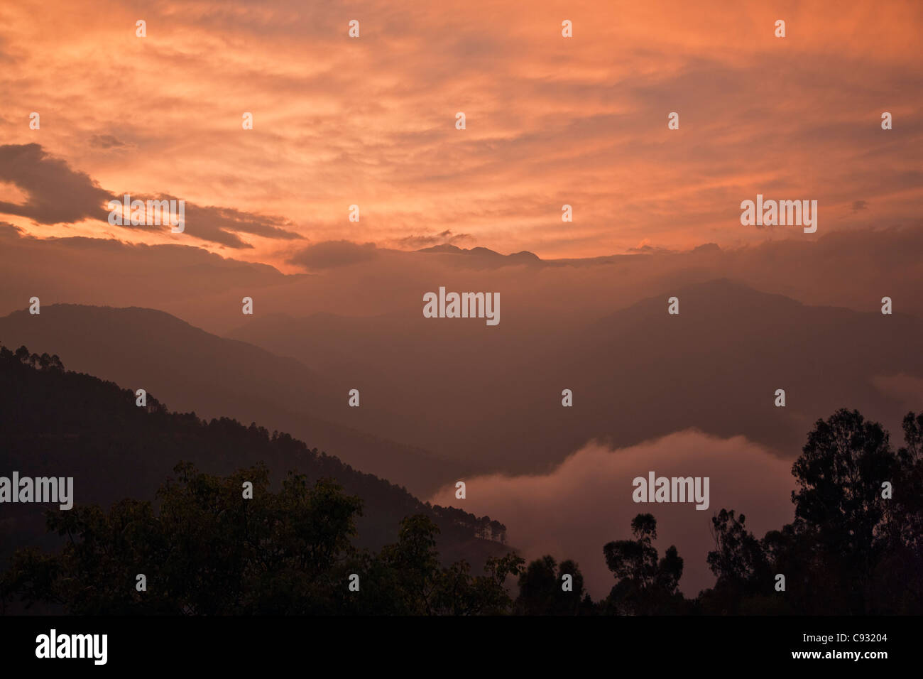 Sunset over the mountains surrounding the hilltop town of Mongar. - Stock Image
