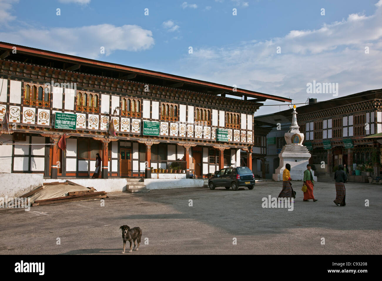 The hilltop town of Mongar showing buildings with the distinctive and decorative architectural style of the Kingdom - Stock Image