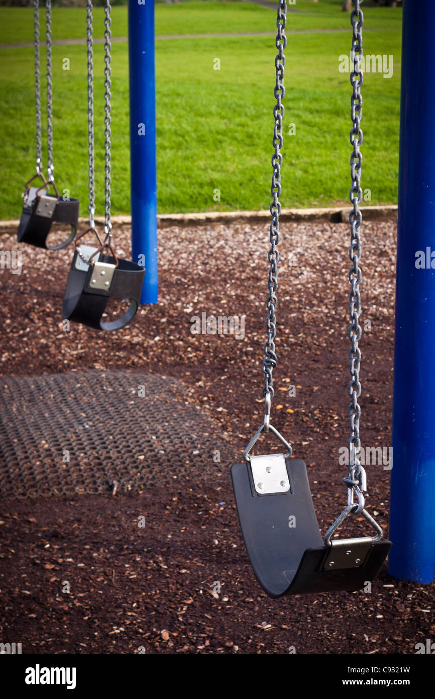 Abstract photo of swing, detail of kids playground. - Stock Image
