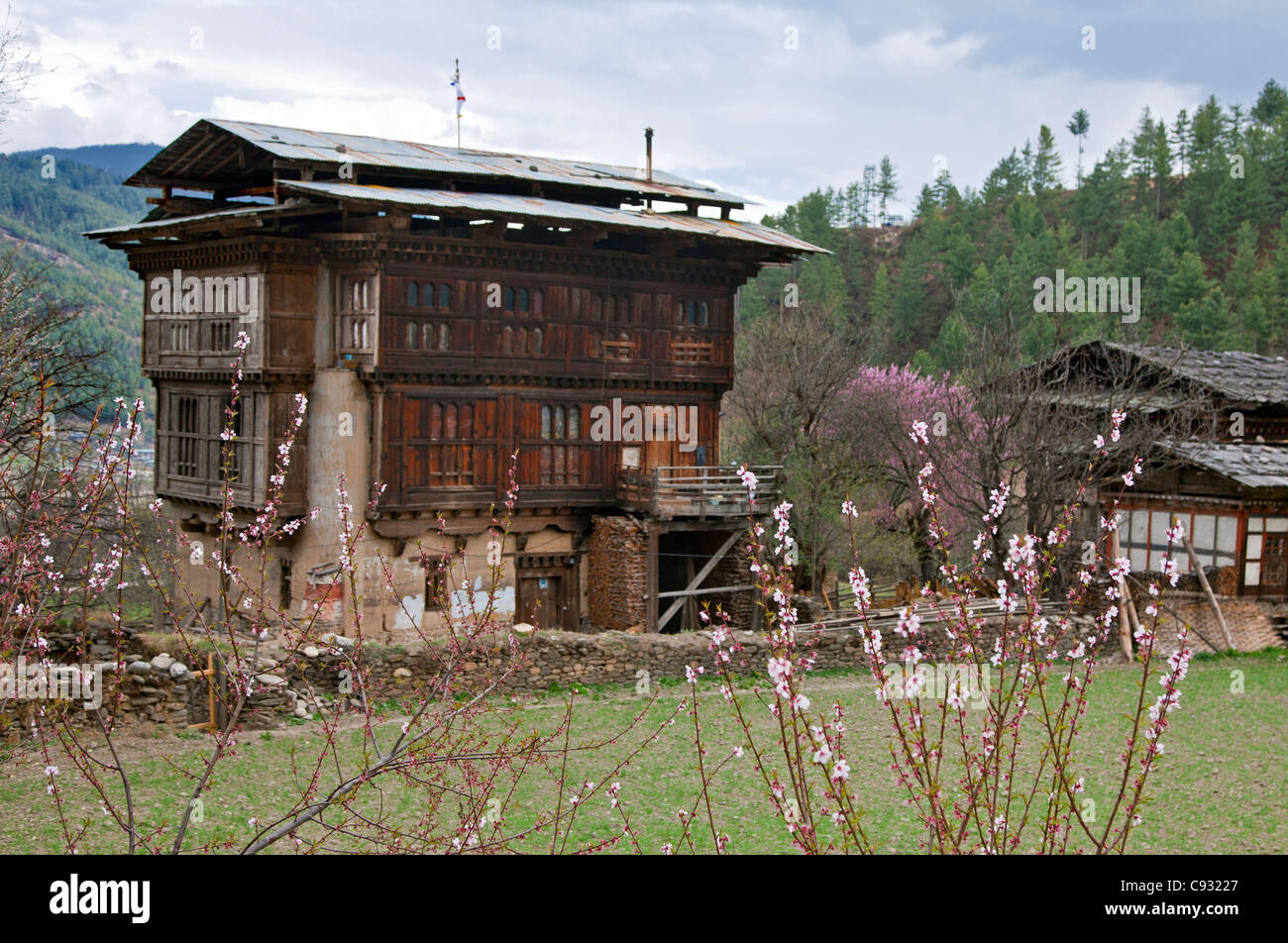 An old farmhouse in traditional Bhutanese architectural style on the outskirts of Jakar. - Stock Image