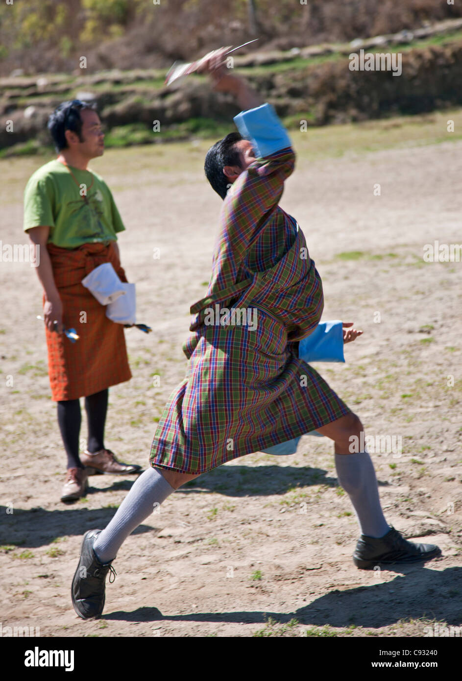 A man throws darts in a Khuru competition, which is a national sport in Bhutan. - Stock Image