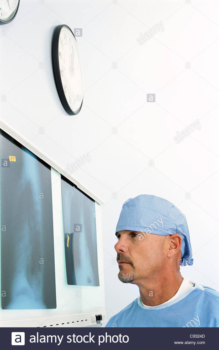 Surgeon examining x-rays - Stock Image