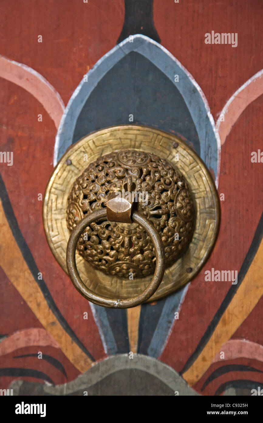 A fine brass door knob of a painted door at Trongsa Dzong, a fortress that was built in the 1640s. - Stock Image