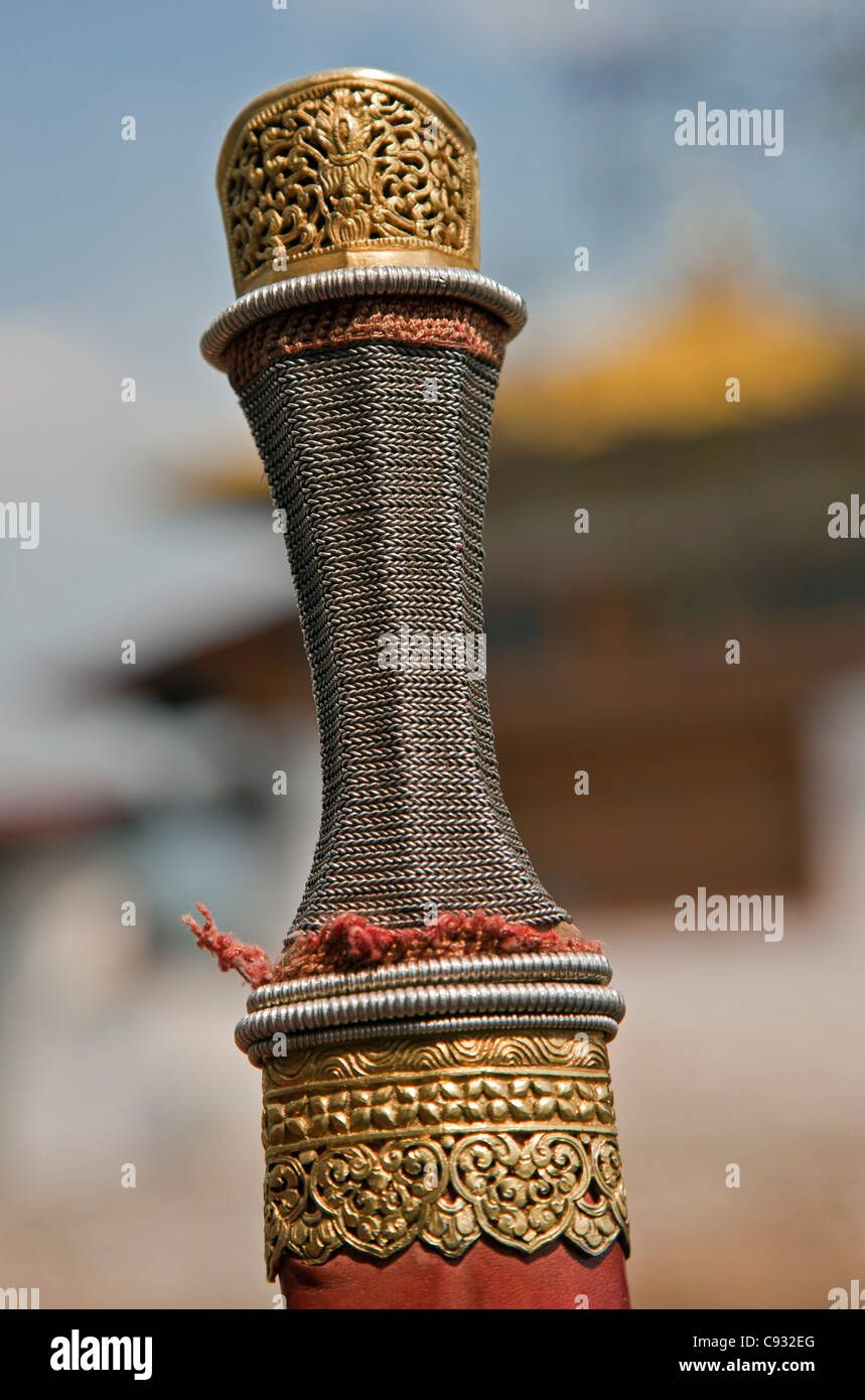 The detail of a gold and silver handle and scabbard of a long sword, patang. - Stock Image