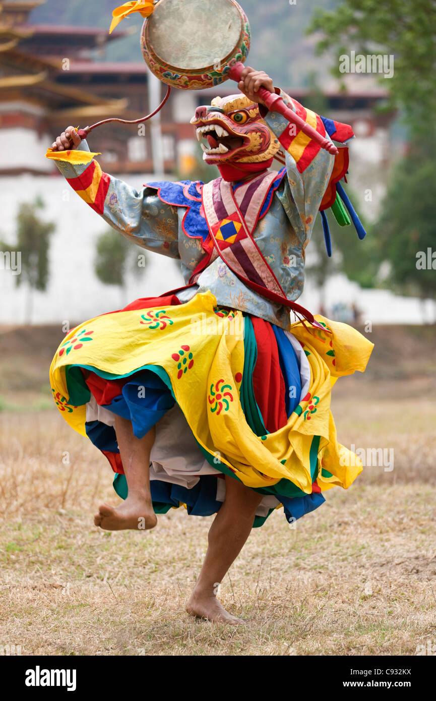 A masked dancer with a lag nga performs Drametse Nga Cham at the Drametse monastery in Eastern Bhutan. - Stock Image