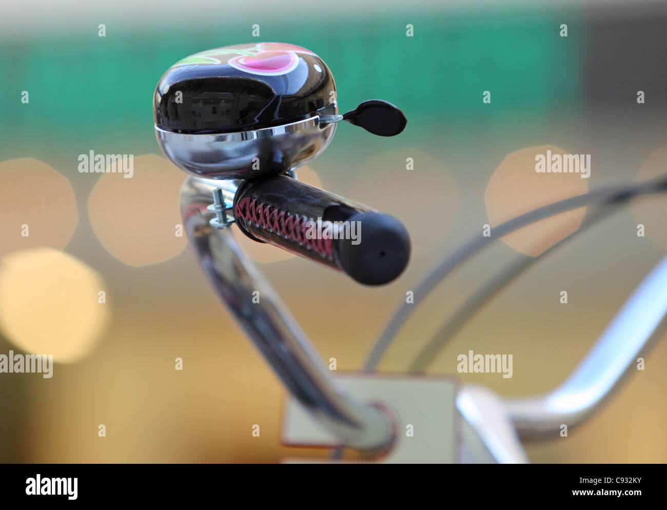 Close up of bicycle bell on handlebars - Stock Image