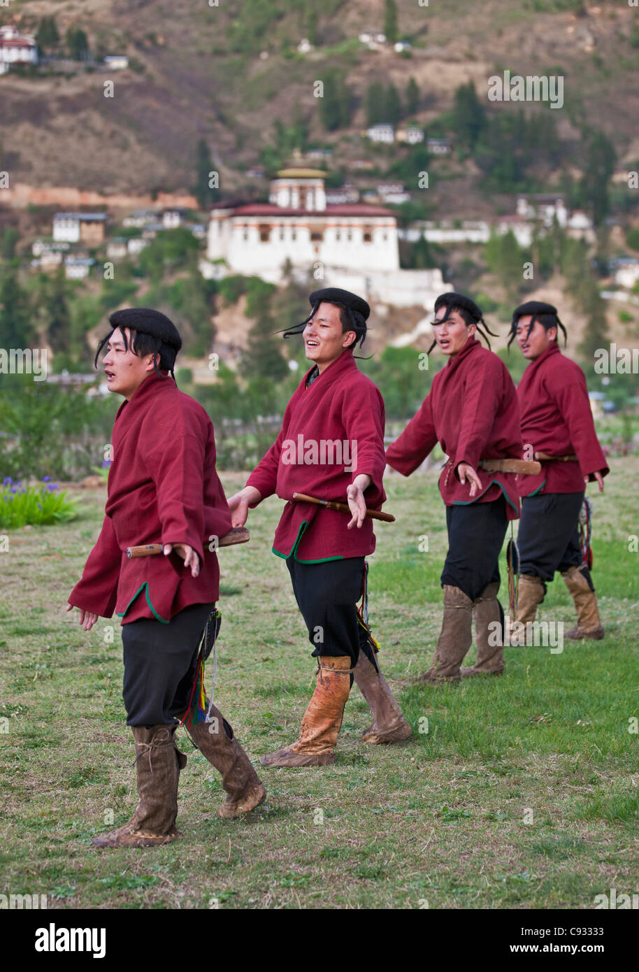 Dancers perform a dance of nomadic yak herders, Layap, who live at high altitude in the far west of Bhutan bordering - Stock Image