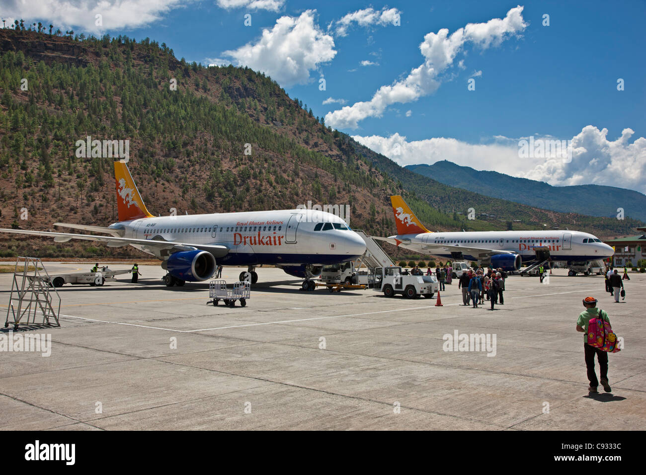 Bhutans only airport is situated at high altitude on the outskirts of Paro. - Stock Image