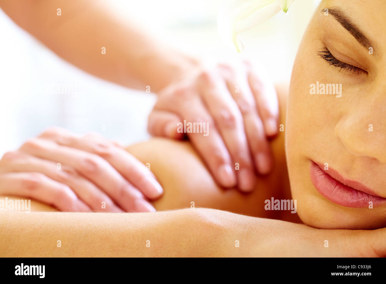 Close-up of calm female during luxurious procedure of massage - Stock Image
