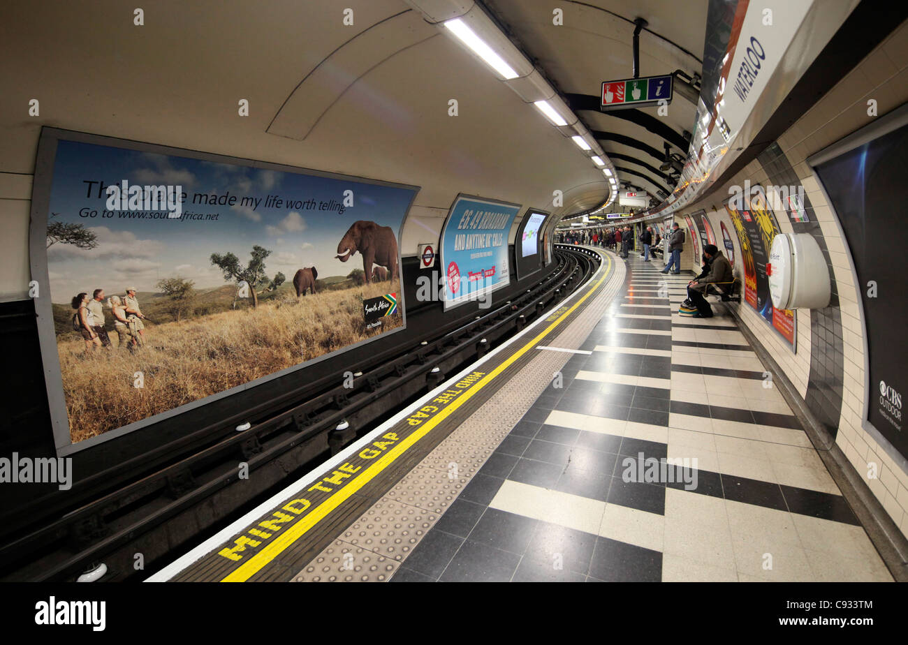 London Waterloo Tube Station with the famours Mind the Gap on the floor. - Stock Image