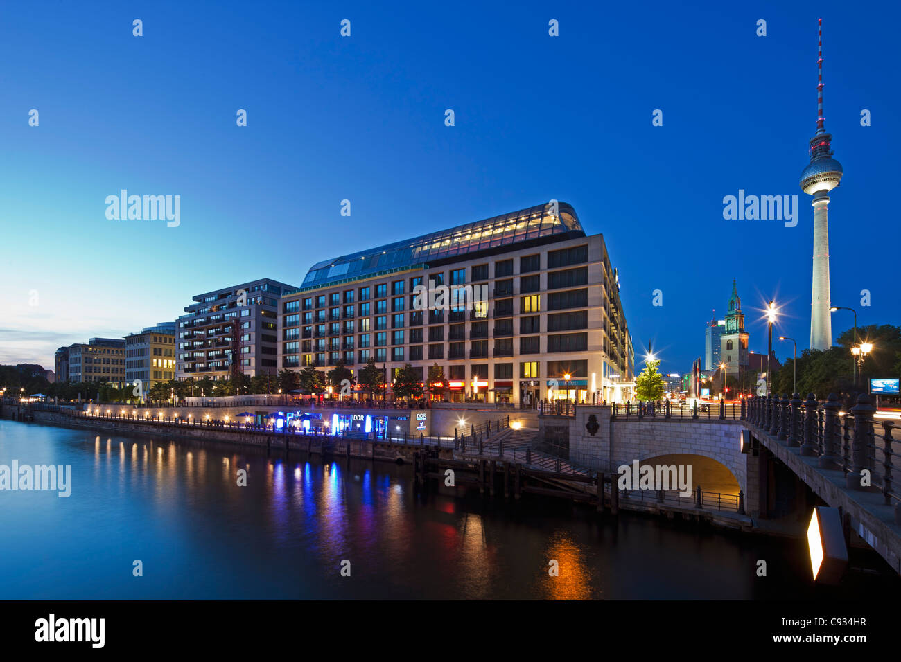 Twilight view of the Radisson Blu Hotel with the Berlin Fernsehturm Tower in the background, Mitte, Berlin, Germany. - Stock Image