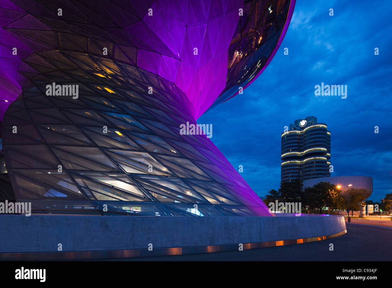 Twilight view of the main entrance to BMW Welt, a exhibition facility of the BMW Company,Munich, Bavaria, Germany - Stock Image