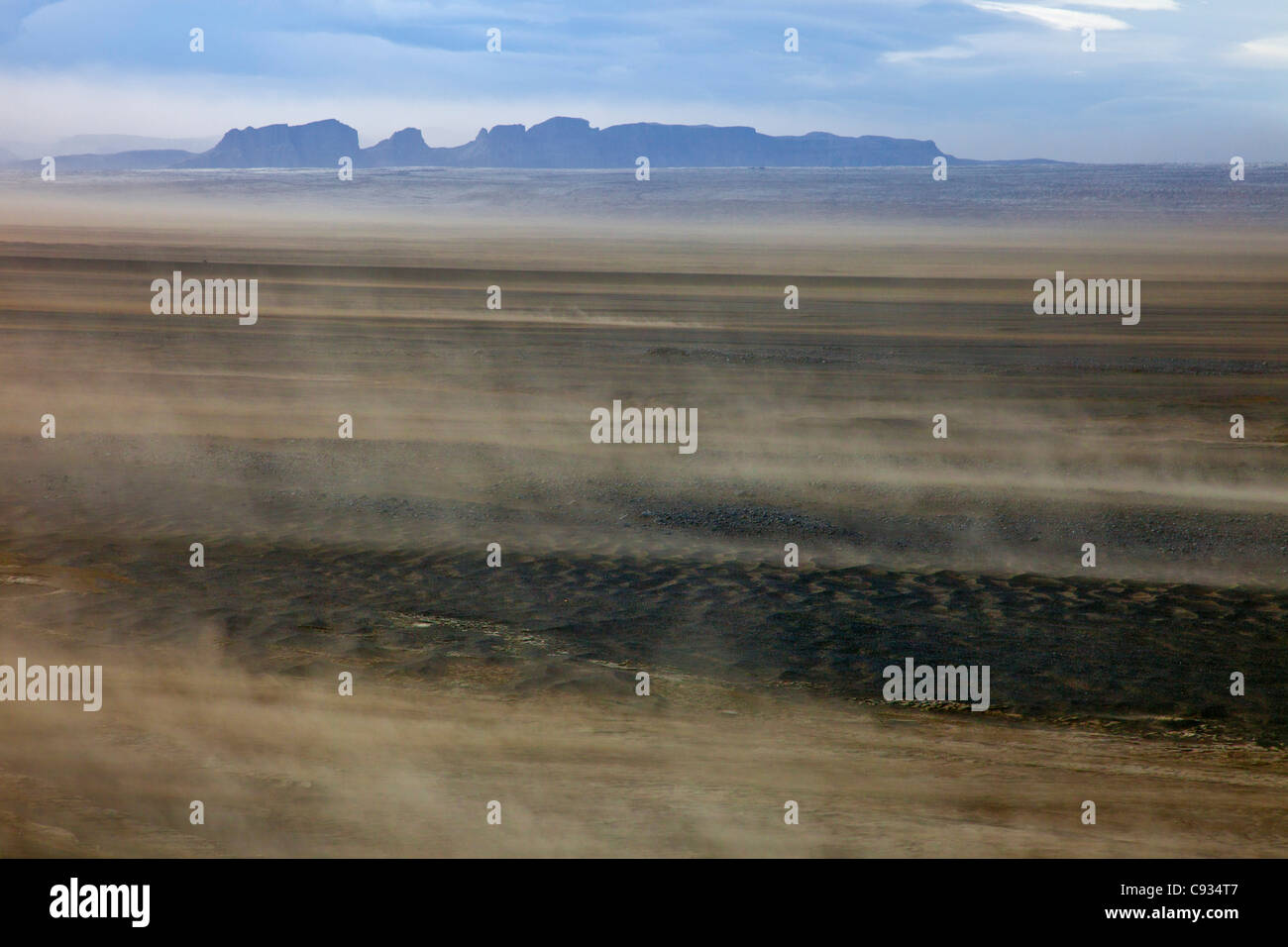 A dust storm of fine volcanic dust whipped up by strong winds across Skeidararsandur in Southeast Iceland. - Stock Image