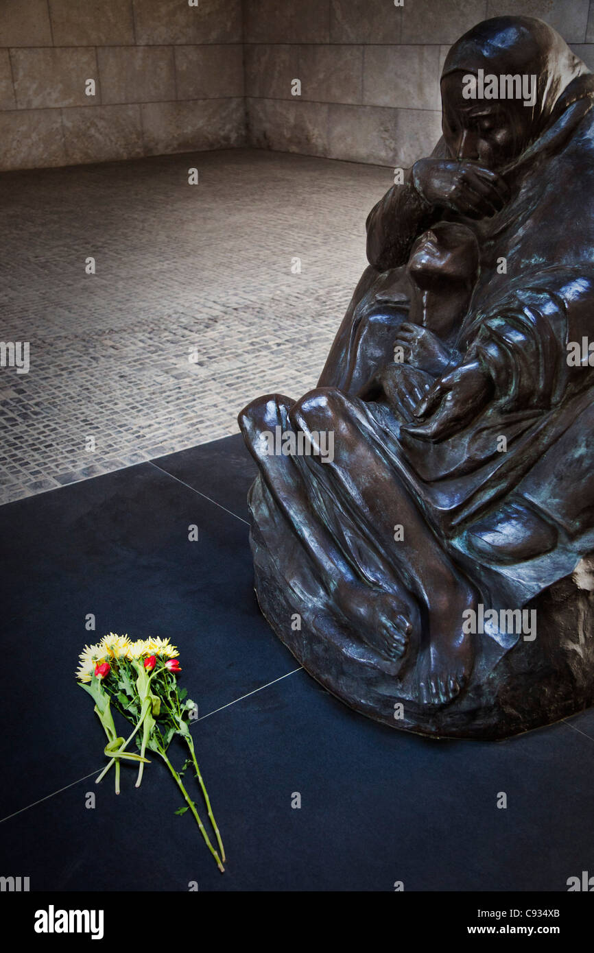 The sculpture Mother with her Dead Son, in the centre of the Central Memorial, Unter den Linden, Berlin, Germany. - Stock Image