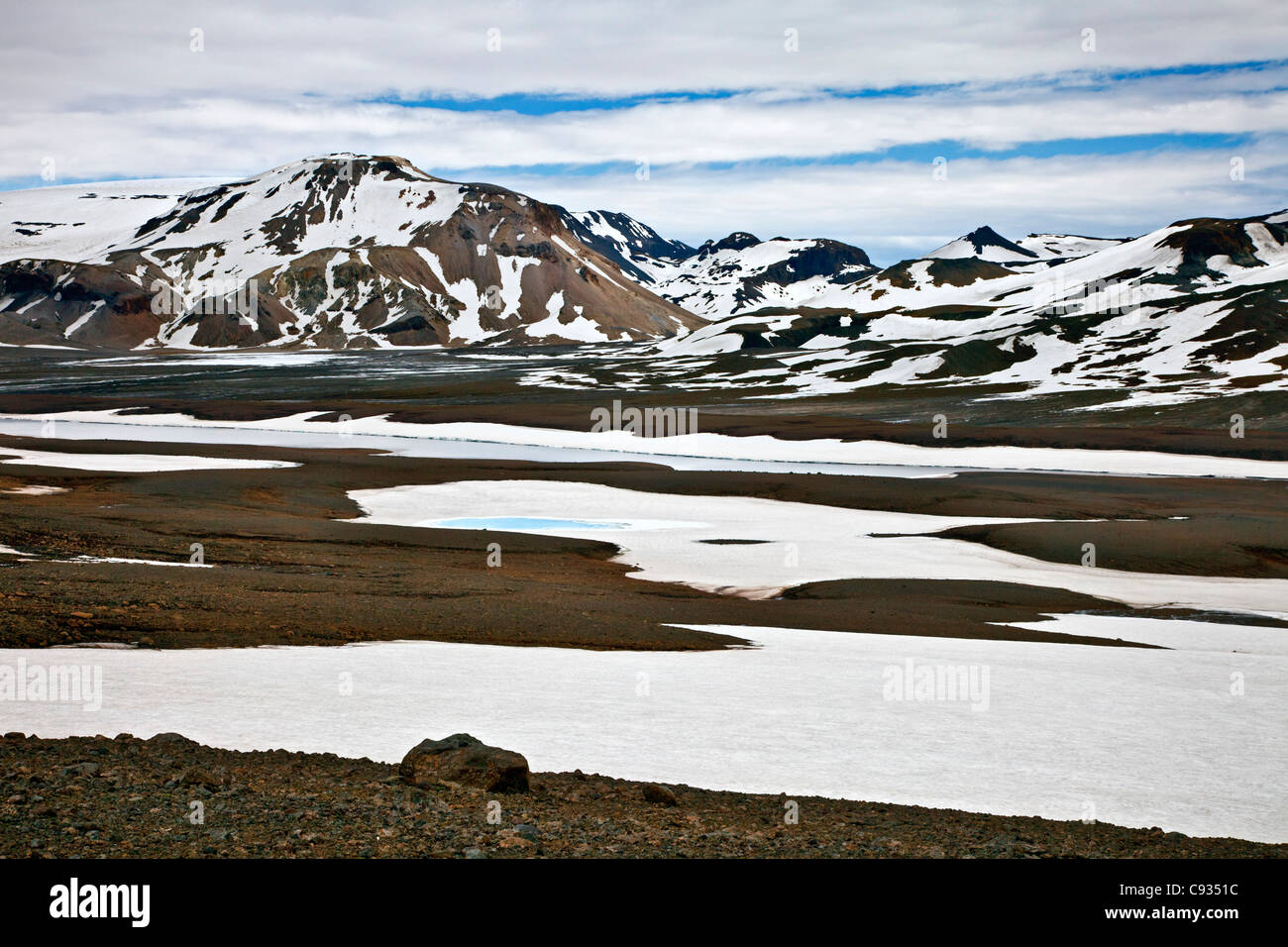 The small glacier and volcano of Porisjokull in Pingvellir National Park in early summer. - Stock Image