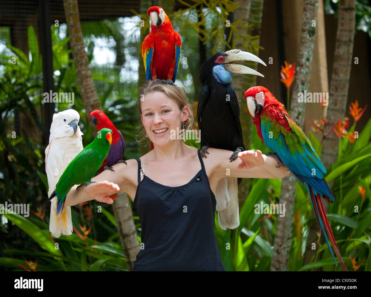 Bali Ubud A Tourist Poses With An Assortment Of Birds At