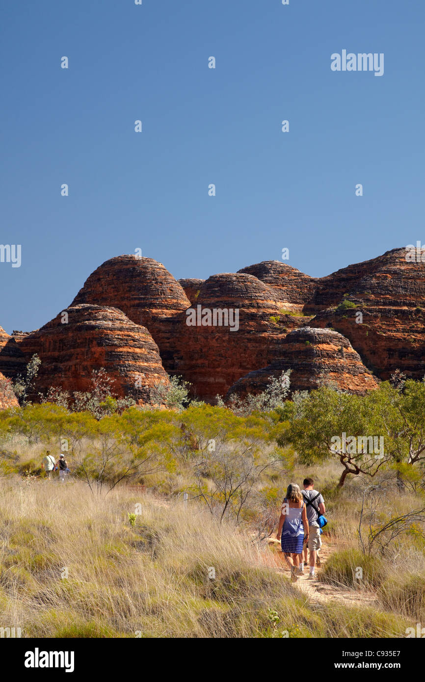 Tourists on track to Cathedral Gorge, Bungle Bungles, Purnululu National Park, Kimberley Region, Western Australia, Stock Photo