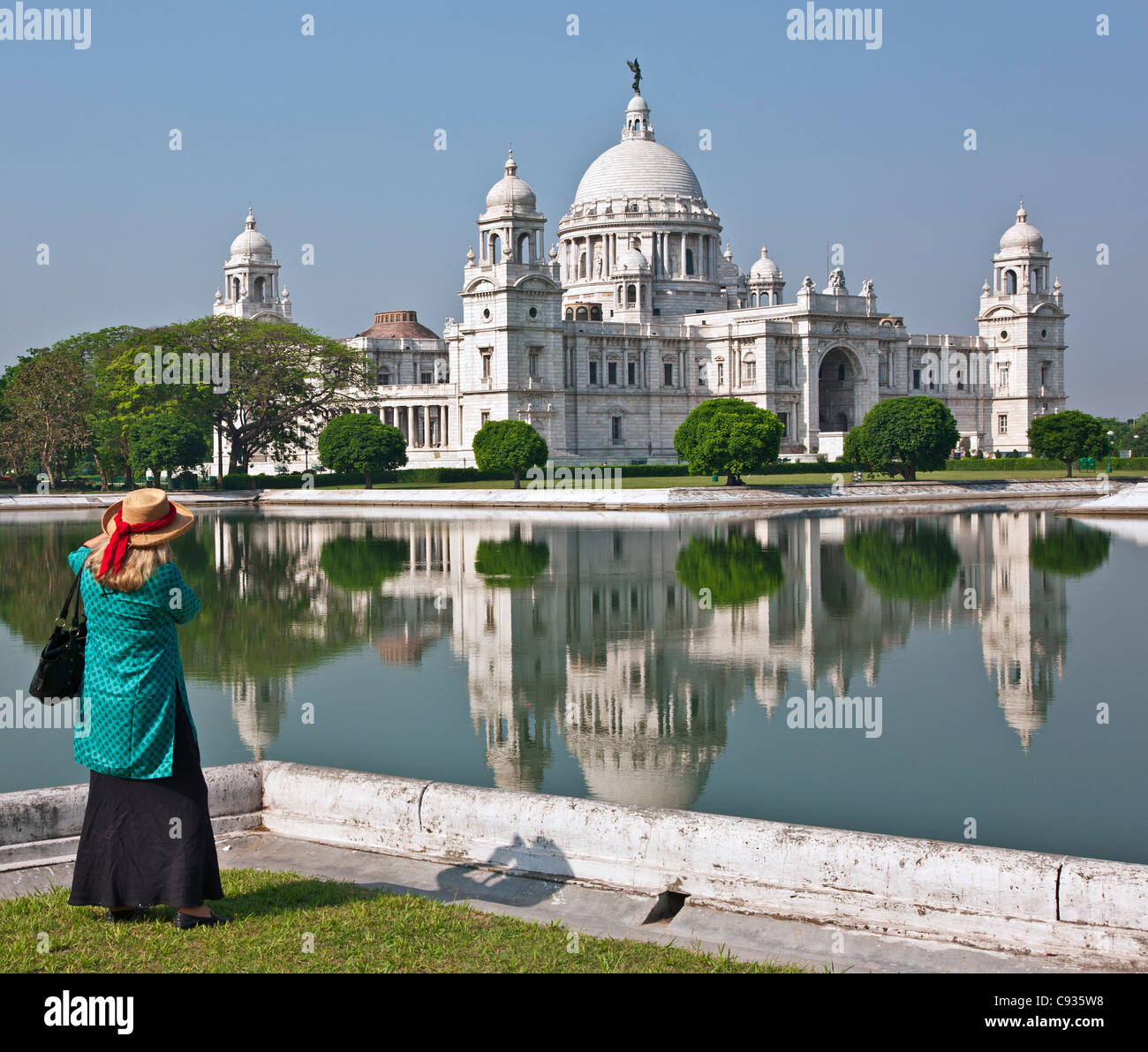 Situated in a well-tended park, the magnificent Victoria Memorial building with its white marble domes. - Stock Image