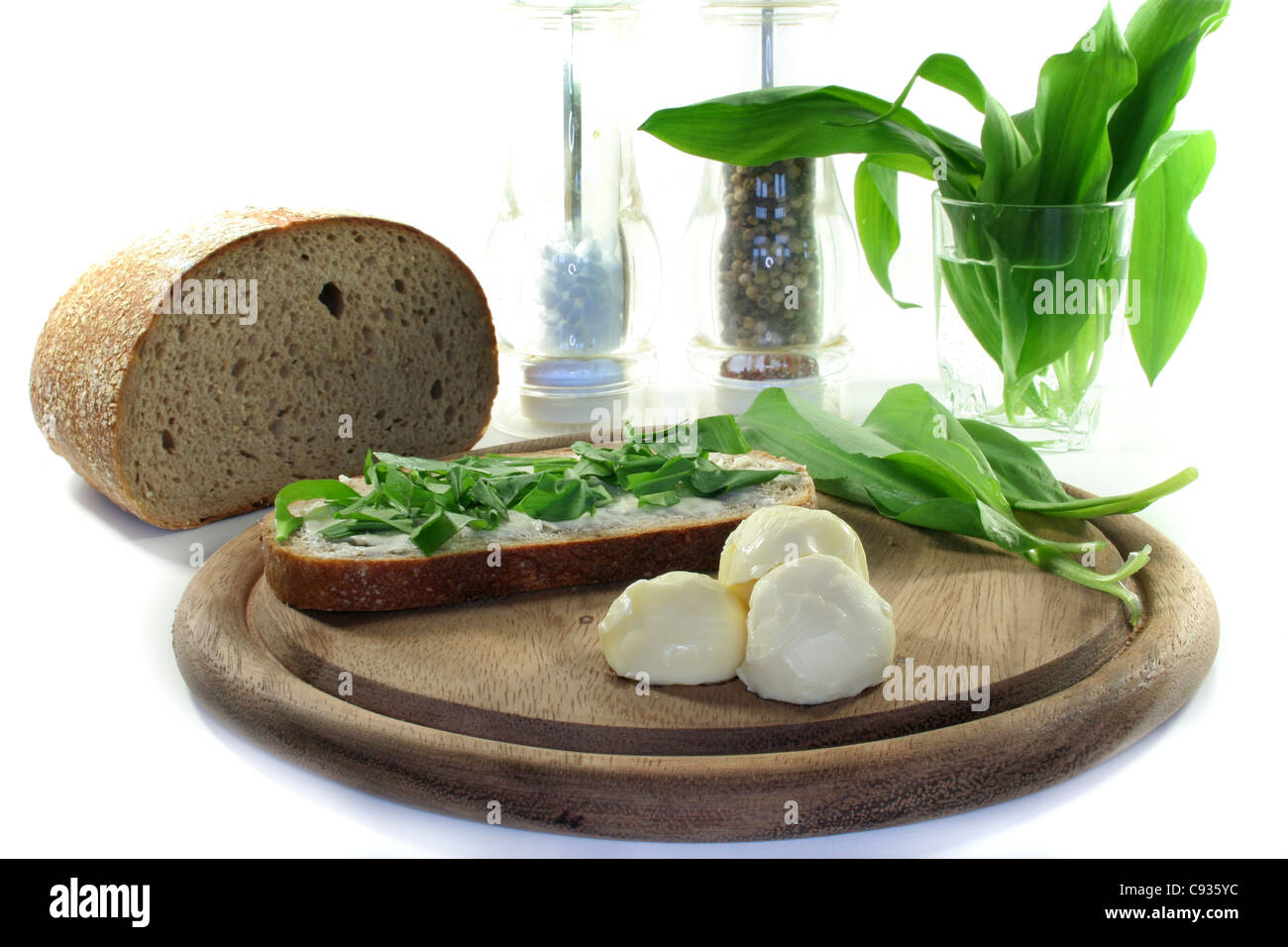a slice of buttered bread with freshly chopped ramson - Stock Image