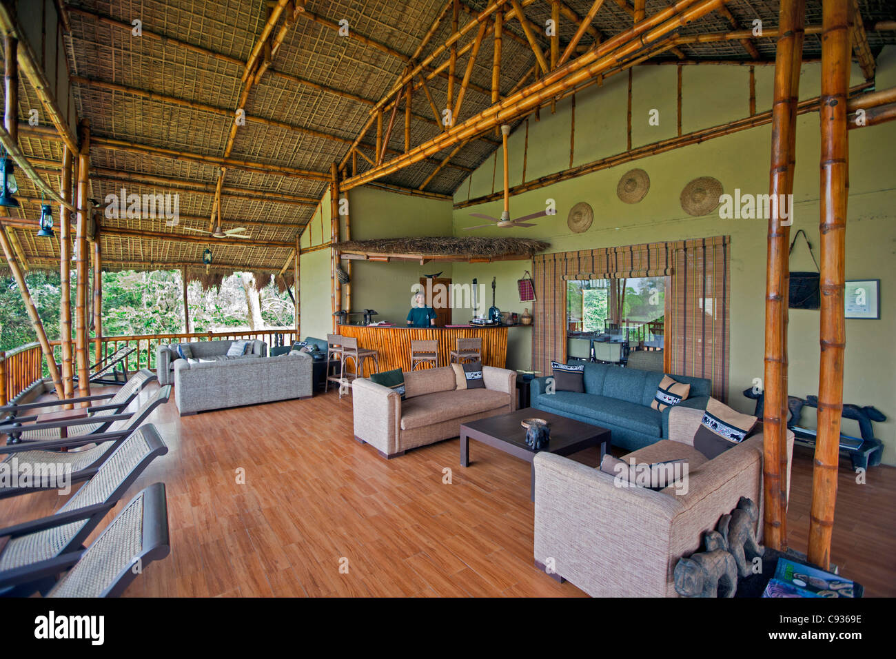 The bar and sitting area of Diphlu River Lodge ideally located next to Kaziranga National Park. - Stock Image