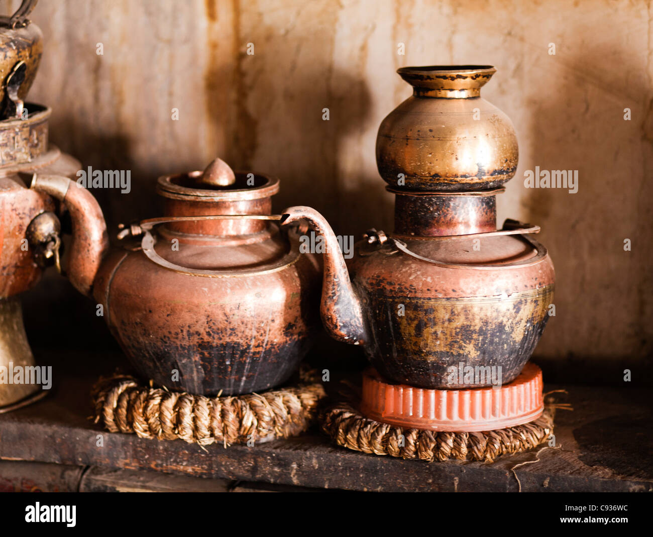 India, Ladakh, Nimmu. Traditional Ladakhi teapots in the kitchen of an aristocrat's old house. - Stock Image