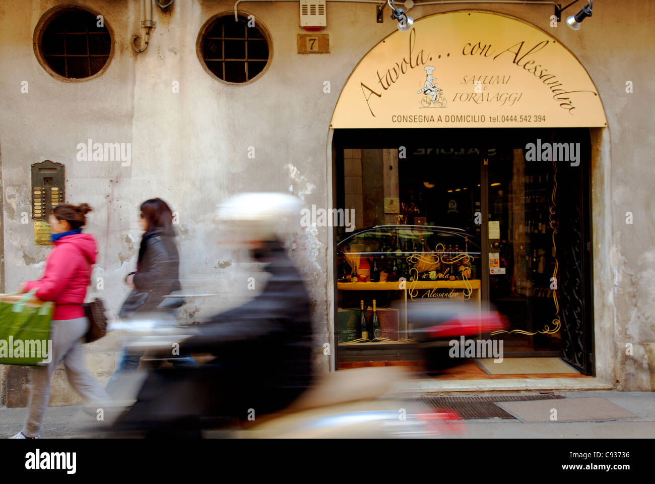 Italy, Veneto, Vicenza, Western Europe;  A 'motorino' passing swiftly in the historic centre - Stock Image