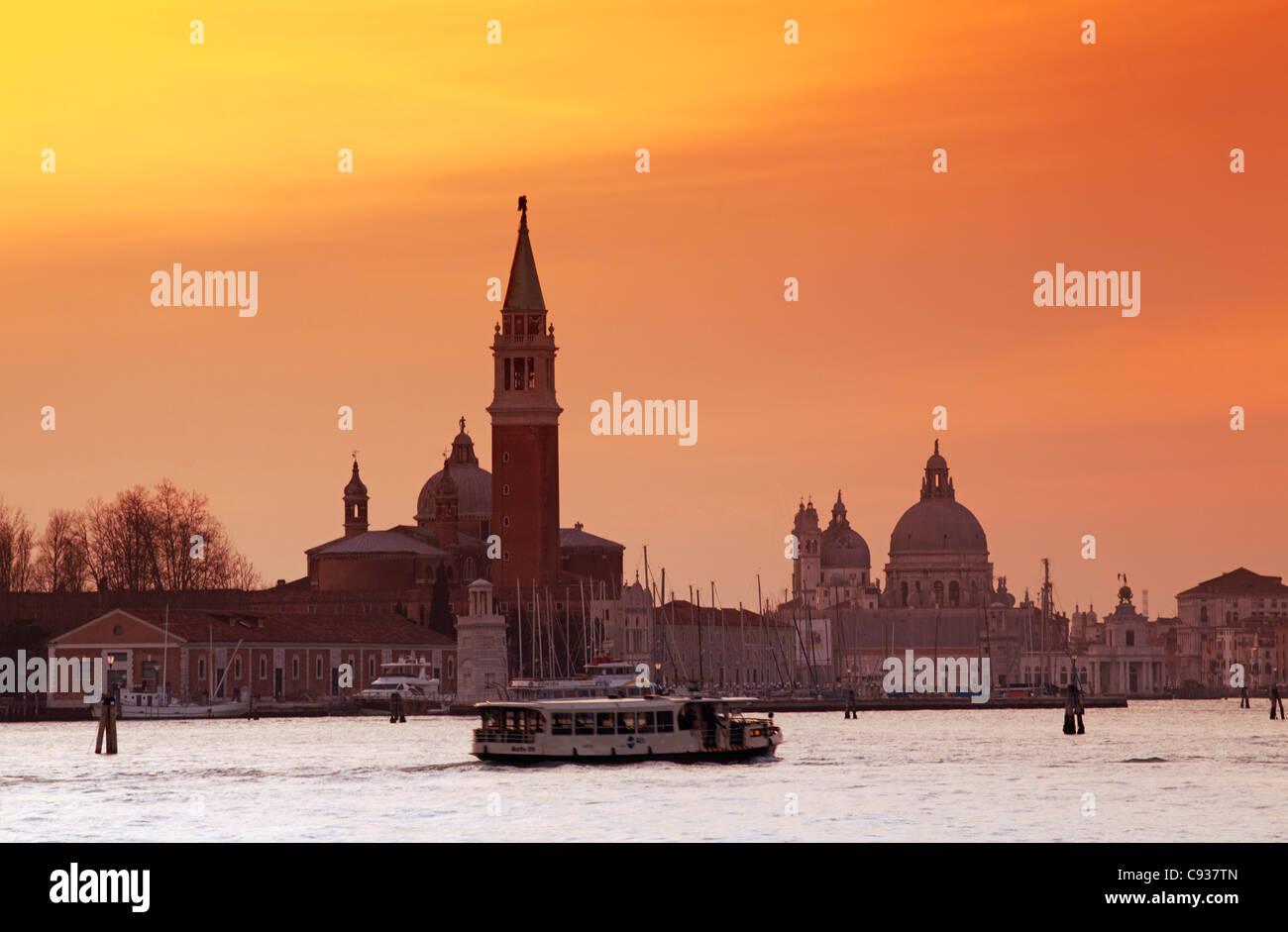 Venice, Veneto, Italy; A vaporetto crossing the Bacino di San Marco - Stock Image