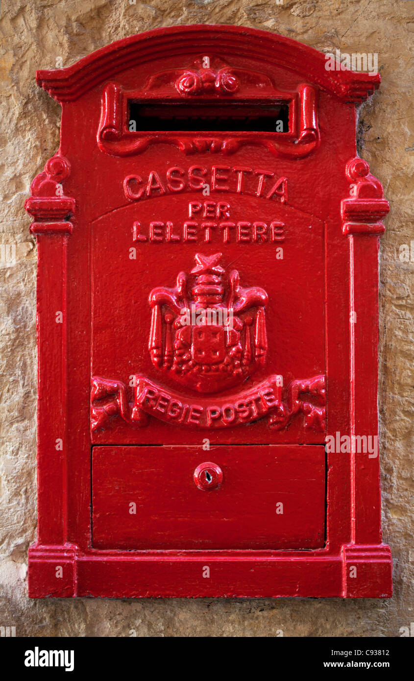 Malta, Europe; A coloured letter box, normally found in village or town cores complimenting colourful doors and - Stock Image