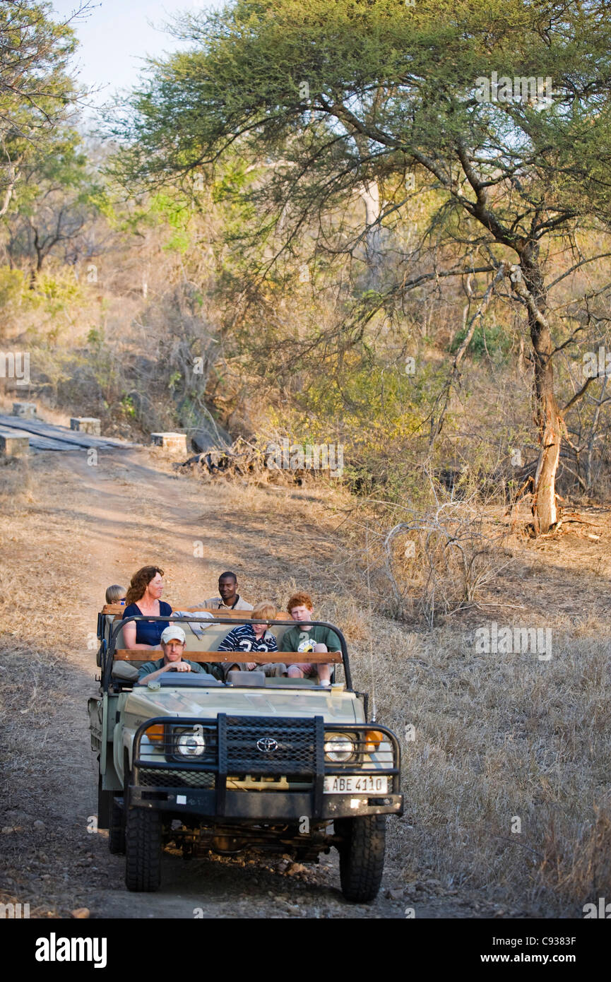 Malawi, Majete Wildlife Reserve.  Family in their safari vehicle whilst on a game drive in Majete. - Stock Image